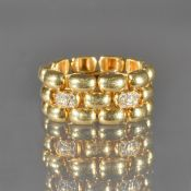 A gold and diamond chain link ring, in a three row domed oval link design,