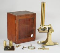 An early 20th century students microscope, lacquered brass,