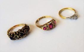 A gold and platinum, diamond set three stone ring,