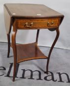 An Edwardian mahogany single drawer drop flap side table on sabre supports,