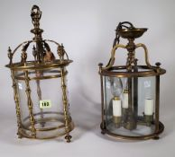 A Victorian style gilt brass hall lantern of circular form with pillar supports and single light