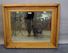 A rectangular pine wall mirror with moulded frame, 86cm wide x 71cm high.