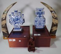 A pair of 20th century carved bovine horns, depicting dragons,
