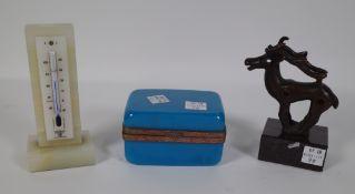 An onyx desk thermometer, 12cm high, a blue glass rectangular casket with gilt metal mounts,