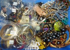 A large collection of costume jewellery, comprising; necklaces, bangles and earrings, (qty).