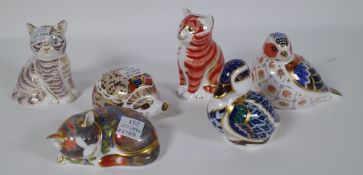 Six Royal Crown Derby Imari paperweights including a duckling, cat, hedgehog, cat,