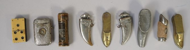 Two early 20th century metal novelty 'shoe' form cigar cutters cum vestas (7cm),