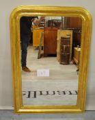 An early 20th century gilt framed rectangular wall mirror with split beading decoration,