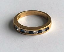 An 18ct gold, sapphire and diamond half-hoop ring,