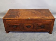 A 20th century hardwood low trunk with three drawers, 120cm wide x 47cm high.