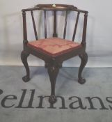 A late George III mahogany corner armchair on ball and claw supports.