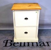 A modern two drawer painted pine cabinet with cup handles and a plinth base, 57cm wide.