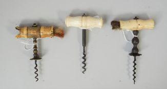 Three mid 19th century straight pull corkscrews, each with tunred bone handle,