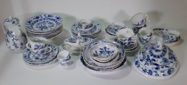 A composite group of blue and white `Onion' pattern porcelain and pottery, late 19th/ 20th century,