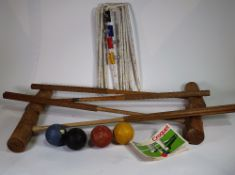 An early 20th century part croquet set, unboxed.