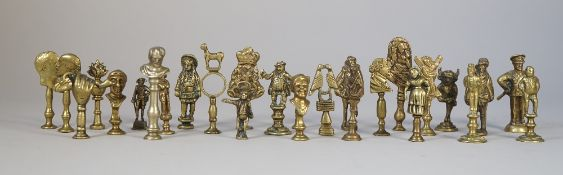 A collection of mid 20th century brass pipe tampers, mainly figural subjects. The tallest 7cm.