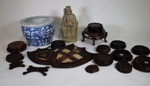 A group of 19th century and later Asian hardwood vase stands,