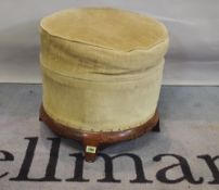 A rosewood framed circular footstool on four splayed sqaure supports, 46cm diameter.