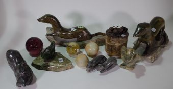 Mostly 20th century carved stone decorative objects, comprising four paperweights,