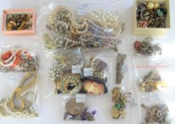 Mostly silver jewellery, comprising; a charm bracelet, two further bracelets, three brooches,