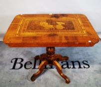 A Victorian mahogany and satinwood inlaid centre table on four outswept supports,