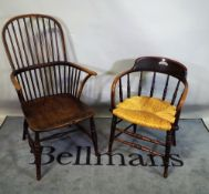A late 18th century elm Windsor armchair and a late 19th century smokers chair, (2).