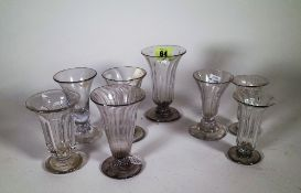 A group of eight jelly glasses, 18th/ early 19th century, each with a bell bowl,