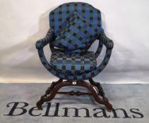 An 18th century style Continental walnut open armchair.