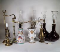 A group of five pairs of 20th century decorative table lamps, including brass and ceramic examples,