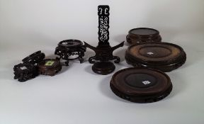 A quantity of Asian hardwood vase stands, (qty).