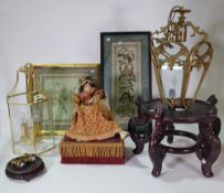 A group of collectables, comprising; a reproduction doll automaton, two Chinese wood stands,