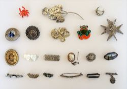 A collection of twenty silver and other brooches, including; a foliate spray, an oval shell cameo,
