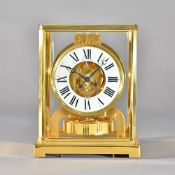 A gilt brass cased Jaegar Le Coultre 'Atmos' clock, serial number 460527, 22.5cm high. Illustrated.
