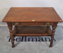 A late 19th century oak Arts & Crafts two tier side table with single drawer,