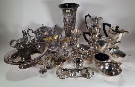 Silver plated wares, including; a vase of tapering form, tea pots, jugs, napkin rings and flatware,
