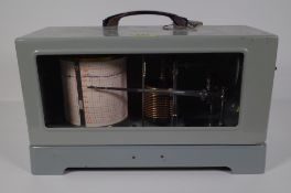 'Ota, Tokyo', a mid-20th century Japanese naval barograph within a grey metal case,