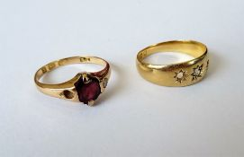 An 18ct gold ring, star gypsy set with a central cushion shaped diamond, (two further gems lacking),