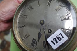 A Negretti and Zambra ship's brass cased port hole wall clock,