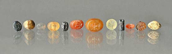 A collection of twelve Ancient mostly agate intaglios, probably Mesopotamian and Sasanian,