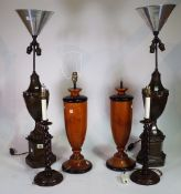 Lighting, comprising; 20th century, a pair of metal urn shaped lamps on octagonal plinth bases,