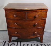 An early Victorian mahogany bowfront chest of two short and two long graduated drawers on bracket
