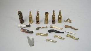 A collection of pipe tampers, early 20th century, modelled and cast as a leg in brass,