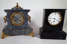A 19th century grey slate mantel clock and a black slate mantel clock, the tallest 28cm high.