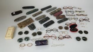 A quanity of vintage spectacles and cases, (qty).
