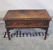 An 18th century Continental oak single drawer low side table, 99cm wide x 64cm high.