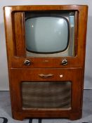 A 'Decca 444' model television in fitted walnut cabinet, 65cm wide x 97cm high.