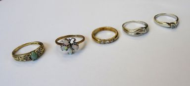 A 9ct gold and diamond three stone ring, mounted with a row of circular cut diamonds,
