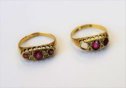 An 18ct gold, ruby and diamond ring, mounted with three rubies,