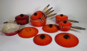 Six Le Creuset volcanic orange saucepans with lids, sizes 22, 20,18,16,16,14, another saucepan,
