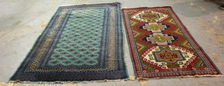 A turquoise Pakistan Bokhara rug, 200cm x 128cm, and a Caucasian rug, 173cm x 89cm, (2).